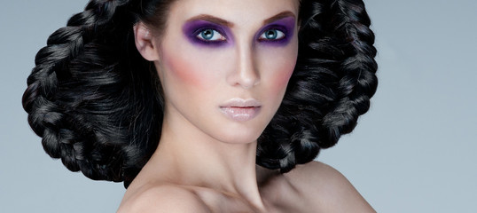 beautiful woman model with professional makeup and  hairstyle