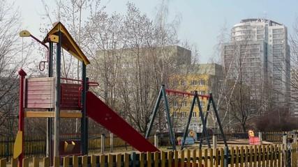 Children's playground and in the background housing development