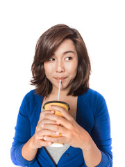 Beautiful young  woman drinking in yellow paper cup with straw o