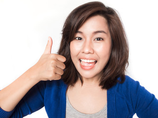 Isolated portrait of beautiful young success woman giving thumbs