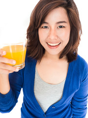 Isolated portrait of young happy woman drinking orange juice smi