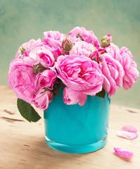 Vintage roses in vase. Bouquet of pink flowers.