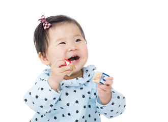 Asia baby girl play with toy block