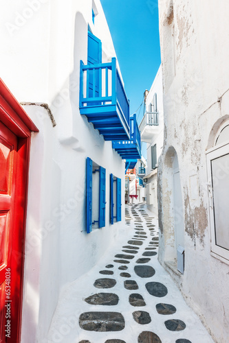 Narrow lane in Mykonos old town - 65348036