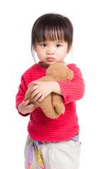 Girl with doll bear