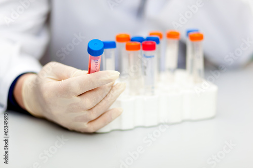 Scientist looking at a test tube