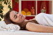 Woman after body massage at spa salon