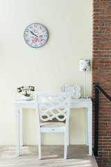 Vintage chair and table on white wall