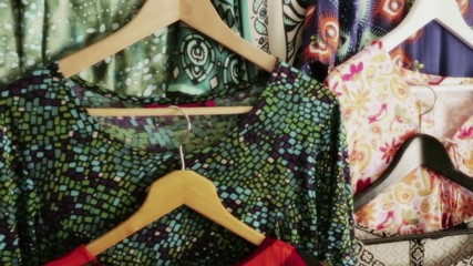 Frocks on hangers, panning right to left