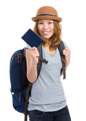 Tourist girl with backpack and passport