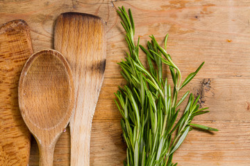 Kitchen utensils: wooden spoons and rosemary