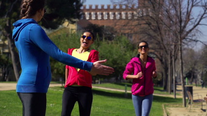 Joggers finish racing in park, slow motion shot at 240fps, stead