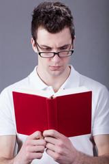 Nerd reading a book