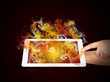 Hands holding tablet pc with colored smoke