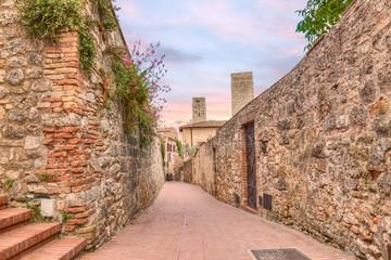 narrow alley in San Gimignano, Tuscany, Italy