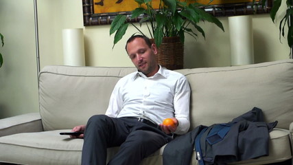 happy businessman resting after work on the sofa, slow motion sh