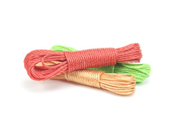 bundles of colorful nylon ropes on white background