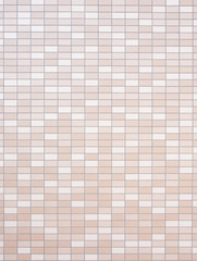 tiled wall of brown and beige