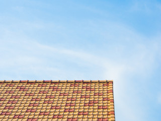 blue sky and colorful roof