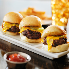 burger sliders with melted cheese and pickle