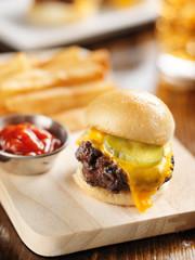 burger slider close up on wood cutting board