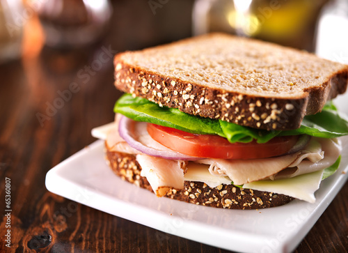 cold cut turkey sandwich on whole wheat with swiss cheese - 65360807