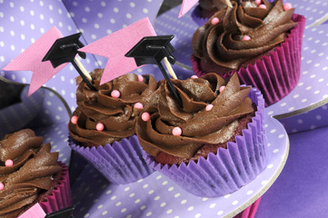 Graduation day pink and purple party cupcakes - angle close up.