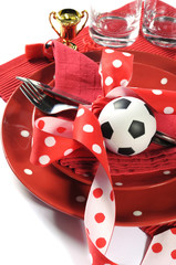 Soccer football party table in red and white team colors - close