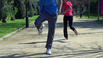 Jogger having muscle contraction, slow motion shot at 240fps, st