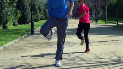 Jogger having muscle contraction, slow motion shot at 60fps, ste