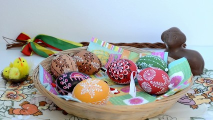 Easter decoration - put painted eggs to the basket