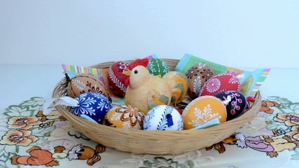 Easter decoration - put basket of painted eggs on the table
