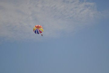Paraglider on the sky dragged by boat. Zlatni Rat, Croatia