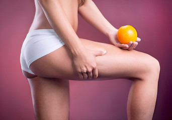 Beauty female body with orange. Healthy lifestyle concept