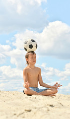 Boy sitting on sand
