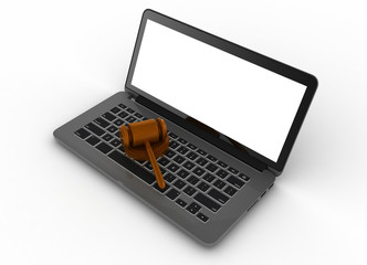 Gavel with a laptop computer