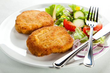 Fried pork chop with vegetables
