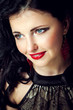 Beautiful young woman with red lips