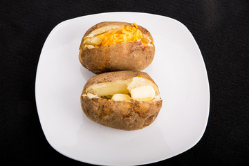 Two Baked Potatoes on White Plate