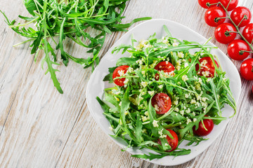 couscous salad with arugula and cherry tomatoes