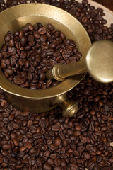 coffee beans and old brass cup
