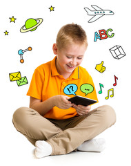 Kid boy sitting with tablet computer and learning or playing wit