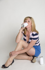Woman drinking alcohol from a metal can