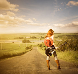 guitar player at sunset freeway