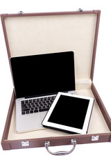 Open laptop with digital tablet in briefcase. isolated on white.