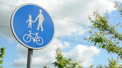 sign - pedestrian zone with blue sky and trees