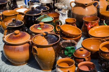 clay pots cups various sizes shapes on fair stall