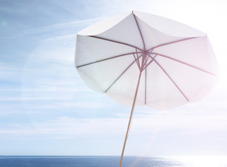 white umbrella on the sea landscape