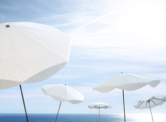 white umbrellas on the beach