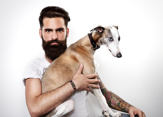 Portrait of a brutal bearded man with his dog